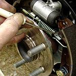 Ajustador mecánico